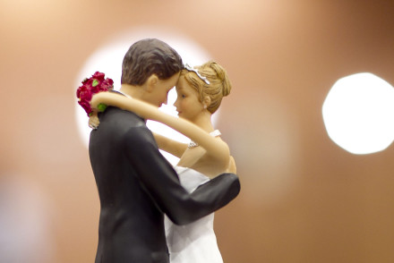 FILE - Figurines of a bride and a groom sit atop a wedding cake in Raleigh, N.C., on Tuesday May 8, 2012. A study of more than 3.5 million Americans finds that married people are less likely than singles, divorced or widowed folks to suffer any type of heart or blood vessel problem. The results were released Friday, March 28, 2014. (AP Photo/The News & Observer, Robert Willett)